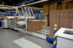 Corrugated cardboard production line. View of corrugated cardboard production line at the plant royalty free stock photography