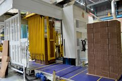 Corrugated cardboard production line. View of corrugated cardboard production line at the plant stock photo