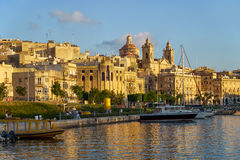 The view of Cospicua city from the water of Dockyard creek. Borm. BORMLA, MALTA - JULY 25, 2015: The view of Cospicua waterfront with the Collegiate Church of Stock Photography