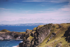 View from the costal path near Polzeath Vintage Retro Filter. Royalty Free Stock Photo