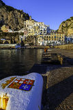 A view of costiera amalfitana. Amalfi harbour, with the town in background Royalty Free Stock Image