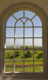 Cotswolds window view. Image taken in Broadway tower, Evesham, Worcestershire, 2010. This idea here was to frame typical Cotswold scenery through a window; in Royalty Free Stock Image