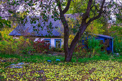 View on Country Home with Yard in Autumn Royalty Free Stock Photo