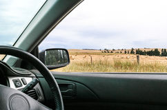 View of country paddocks from car window Royalty Free Stock Images