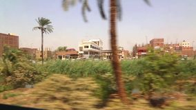 Aswan Egypt from train HD Video. View of country side from train Aswan Egypt Africa stock footage