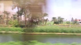 View of country side from train HD Video. View of country side from train Aswan Egypt Africa stock footage
