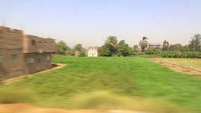 View of country side from train HD Video. View of country side from train Aswan Egypt Africa stock video