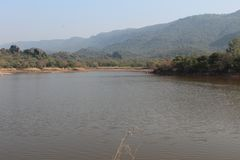 A view of the lake and hills in the background stock images