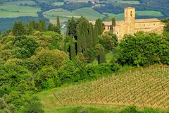 View of countryside and a farmhouse near Montalcino, Val d`Orcia Stock Image