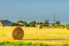 Countryside and haystacks in Hauts-de-France. View of countryside and haystacks in Hauts-de-France, France royalty free stock photos