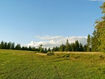 View of the countryside and meadows in the high mountains. Stock Photos
