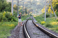 View of countryside Railroad and Hiker waiting the Train Stock Photography