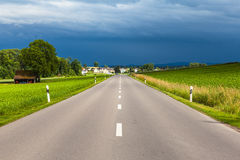 View of countryside road after thunder storm Royalty Free Stock Photos