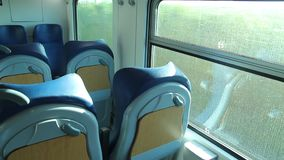 View of Countryside from a Window of a Train. From a Passenger Train to Florence stock footage