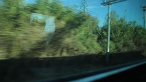 View of Countryside from a Window of a Train stock footage
