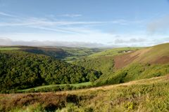 View over Exmoor from County Gate, North Devon. View from County Gate over valley to heather moors in Exmoor, North Devon royalty free stock photo