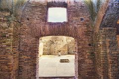 View of the courtyard  from the interior of the Caseggiato del Termopolio. A Roman chambers with rooms and tavernas that develop around a courtyard Stock Image