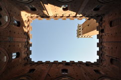 View from courtyard of Torre del Mangia and Palazzo Pubblico Siena Royalty Free Stock Photo