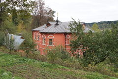 View on the courtyard with a vegetable garden next to the Hermitage of Savva Storozhevsky near Zvenigorod, Moscow region. A building where monks reside next to Stock Photo