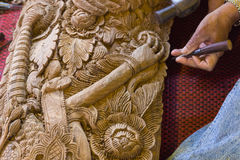 The view of the craftsman's hand using the chisel to engrave tha Stock Photo