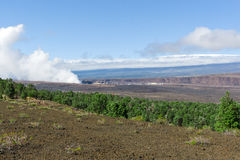 View of crater and old lava field in Hawaii Volcanoes Park Royalty Free Stock Photography