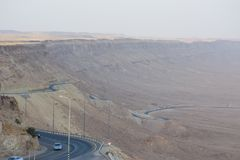 View of the crater from the rock. National park HaMakhtesh Mitzpe Ramon. danger road. Negev,Israel. View of the crater from the rock. National park HaMakhtesh Stock Photography