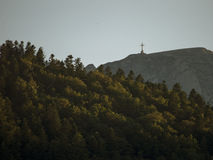 View of the cross on the top of Bucegi mountains Stock Photo