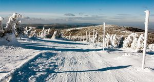 View of crosscountry skiing way and mount Serak Stock Photography