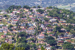 View of Crowded Low Cost Residential Housing Settlement. DURBAN, SOUTH AFRICA - APRIL 18, 2017: Above view of crowded low cost residential housing settlement Stock Photos