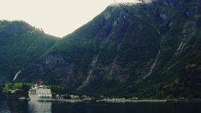 View of cruise liner on river at huge mountains covered by green woods. Nature. Landscape. Seagulls stock footage