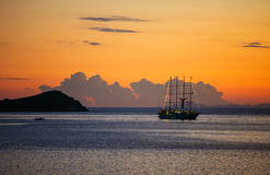 View of cruise sailing ship at sunset Stock Image