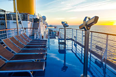 View of cruise ship deck, ocean and sunrise Stock Photos