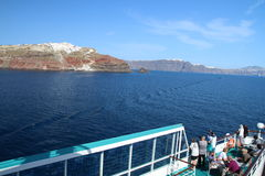 View from a cruise ship to the little town of Oia on the top of Royalty Free Stock Photo