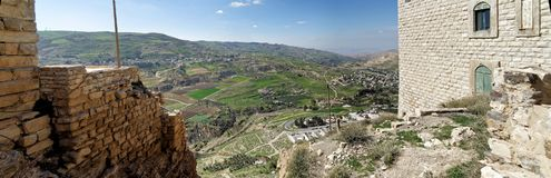 View from the Crusader castle to a small Jordanian village, a suburb of the big city Karak. Middle east Royalty Free Stock Images