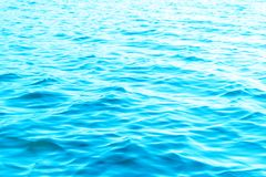 View of a Crystal clear sea water texture. View from above Natural blue background. Turquoise ripple water reflection in tropical. Beach. Blue ocean wave stock photos