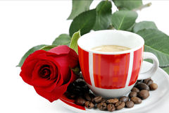 View of a cup of coffee with a red rose and coffee beans on whit Royalty Free Stock Image