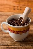 View on cup full of coffee beans Stock Images
