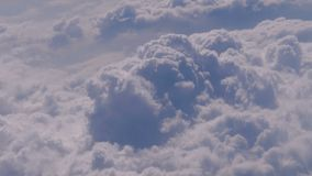 View of the curly clouds from the window of the plane stock footage