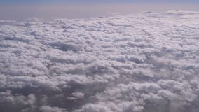 View of the curly clouds from the window of the plane stock video footage