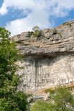 View of the curved cliff at Malham Cove in the Yorkshire Dales N. Ational Park Stock Photography