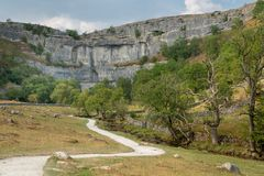 View of the curved cliff at Malham Cove in the Yorkshire Dales N. Ational Park Royalty Free Stock Photo