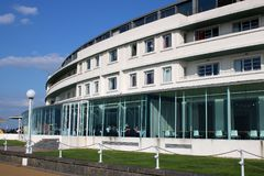 Art deco Midland Hotel, Morecambe, Lancashire, UK. View of the curved front facade of the iconic art-deco Midland Hotel on the promenade at Morecambe, Lancashire royalty free stock images