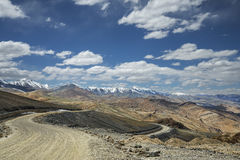 View of curved road among snow capped mountains Stock Photography