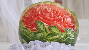 View at cutted rose inside fresh watermelon. Creative cookery, service. Sunny day. Fruits.  stock video footage