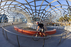 View of cyclist riding along the Webb Bridge in. Melbourne, Australia - May 18, 2015: View of cyclist riding along the Webb Bridge in Docklands, Melbourne. Webb Royalty Free Stock Photography
