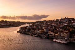 View from D. Luis bridge to the city of Porto and to the Douro river at sunset royalty free stock image