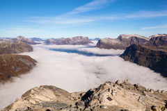View from Dalsnibba mountain to clouds over Geiranger Norway Royalty Free Stock Images