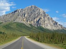 View of Dalton Highway with mountains, leading from Fairbanks to Prudhoe Bay, Alaska, USA Royalty Free Stock Photo
