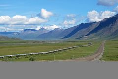View of Dalton Highway with oil pipeline, leading from Valdez, Fairbanks to Prudhoe Bay, Alaska, USA. View of Dalton Highway with oil pipeline, leading from Royalty Free Stock Photo