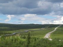 View of Dalton Highway with oil pipeline, leading from Valdez, Fairbanks to Prudhoe Bay, Alaska, USA. View of Dalton Highway with oil pipeline, leading from Stock Image